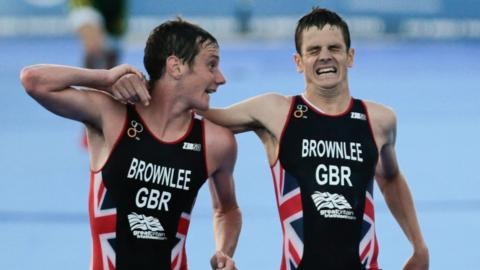 Jonny Brownlee is helped over the finish line by brother Alistair