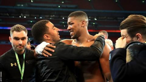 Troy Deeney congratulates Anthony Joshua