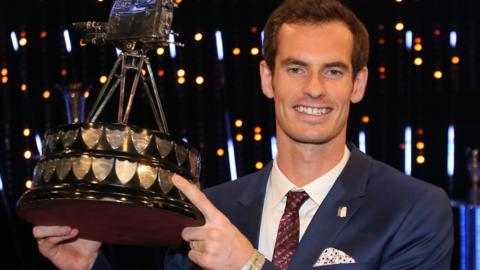 Andy Murray lifts the Sports Personality trophy