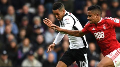 Tom Ince of Derby County and Michael Mancienne of Nottingham Forest battle for possession