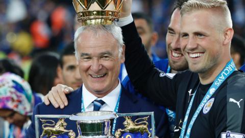 Claudio Ranieri and Kasper Schmeichel with the Premier League trophy