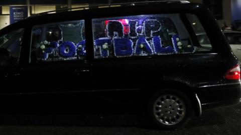Hearse with 'RIP football' in flowers