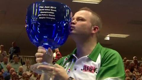 Paul Foster kisses his trophy