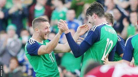 Conor Washington is congratulated by fellow goalscorer Kyle Lafferty at Windsor Park