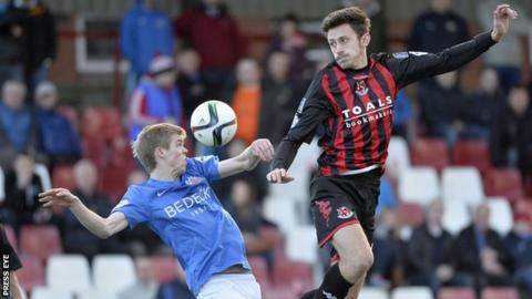Glenavon's Rhys Marshall and Crusaders' Jordan Forsythe battle during the Premiership game in October