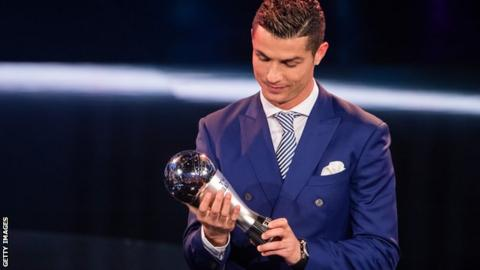 Cristiano Ronaldo holding his trophy after being crowned the world's best player