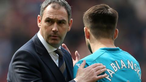 Swansea City manager Paul Clement consoles goalkeeper Lukasz Fabianski
