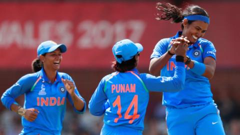 India celebrate a wicket by Shikha Pandey (right)