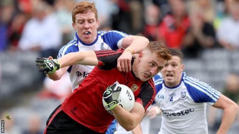 Monaghan's Kieran Duffy challenges Down's Sean Dornan