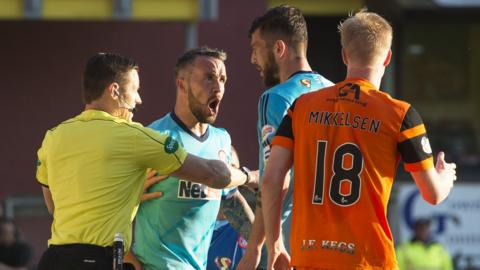 Hamilton and Dundee United players with referee Steven McLean