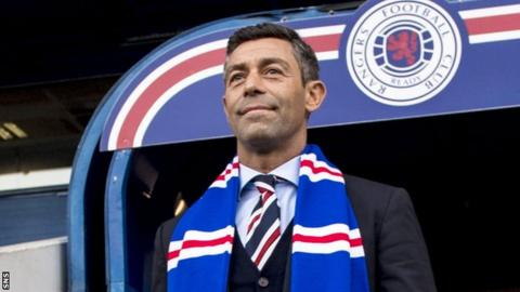 Pedro Caixinha with a Rangers scarf at Ibrox