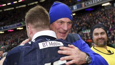 Scotland head coach Vern Cotter embraces full-back Stuart Hogg