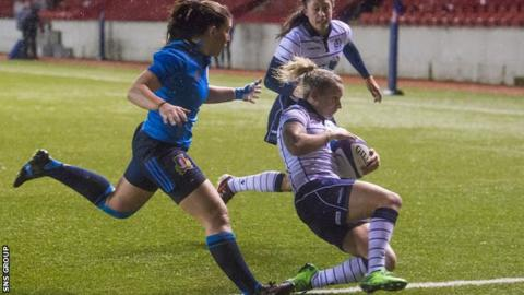 Chloe Rollie slides in for her second try of the evening