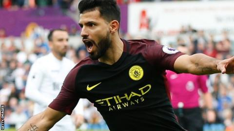 Manchester City striker Sergio Aguero celebrates scoring against Swansea City