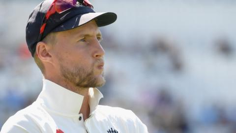 Joe Root looks on dejectedly