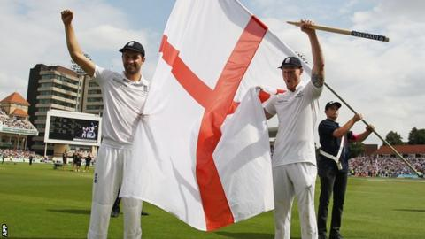 Mark Wood and Ben Stokes celebrate with an England flag