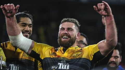 Callum Gibbins celebrates after the Hurricanes beat the Lions to win the 2016 Super Rugby final