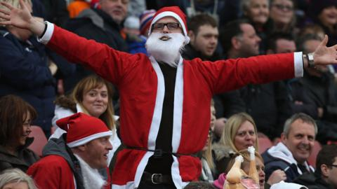 Football fan Father Christmas