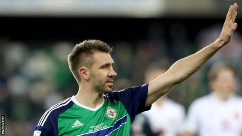 Gareth McAuley waves to Northern Ireland fans after the win over Norway in March