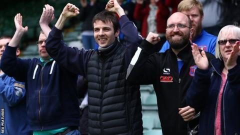 Carlisle United fans celebrate at Yeovil
