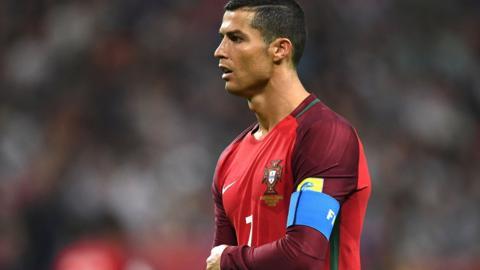 Cristiano Ronaldo looks on