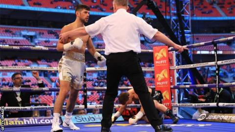 The referee calls a halt as Joe Cordina stops Sergej Vib inside a round at Wembley Stadium