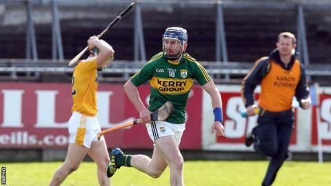 John Egan after hitting Kerry's winning point in the relegation play-off in April as Antrim's Odhran McFadden shows his dejection