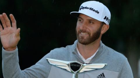 Dustin Johnson holds the Genesis Open trophy