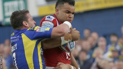 Mason Caton-Brown is tackled by Kurt Gidley