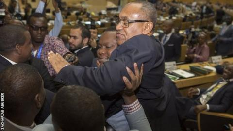 New Caf president Ahmad is held aloft