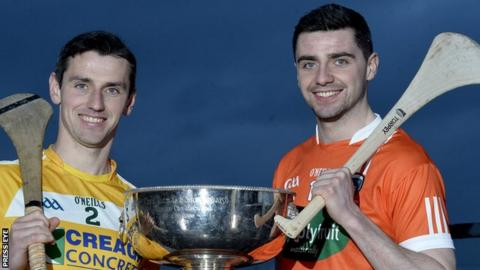 Antrim captain Simon McCrory with Shea Gaffney of Armagh