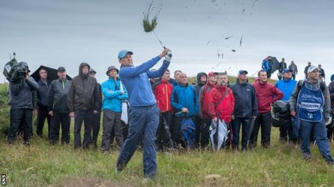 Ian Poulter lashes one out of the rough at rain-lashed Dundonald Links
