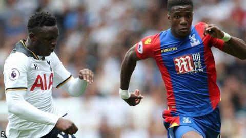 Wilfried Zaha takes on Tottenham's Victor Wanyama