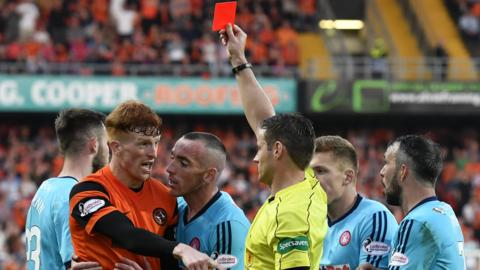 Simon Murray is sent off