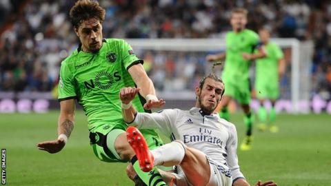 Gareth Bale of Real Madrid challenges Sebastian Coates of Sporting Lisbon