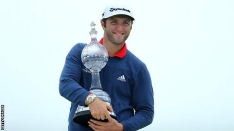 Jon Rahm of Spain poses with the trophy after his victory during the final round of the Irish Open