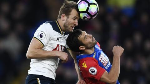 Harry Kane in action with Crystal Palace's Luka Milivojevic