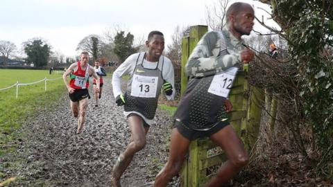 Olympic steeplechase champion Conseslus Kipruto follows Abraham Cheroben during the men's race in Antrim