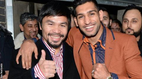 Manny Pacquiao (left) with Amir Khan last month