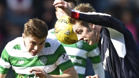 Celtic's James Forrest and Dundee's Kevin Holt