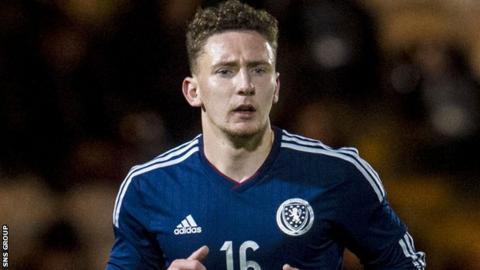 Callum McFadzean in action for Scotland U21