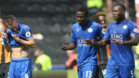 Leicester defender Wes Morgan talks to team-mate Daniel Amartey at the final whistle