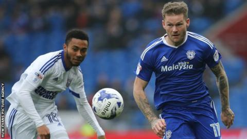 Cardiff City's Aron Gunnarsson wins the ball from Grant Ward