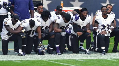 Baltimore Ravens players kneel during the national anthem at Wembley