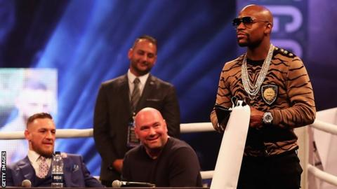 Conor McGregor, Dana White and Floyd Mayweather