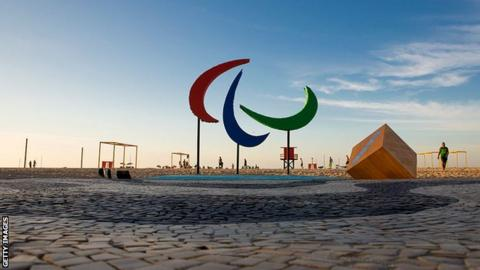 The Paralympic symbol, displayed at Copacabana beach during a sunrise