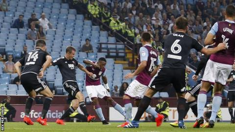 Jonathan Kodjia shoots Aston Villa ahead against Brentford