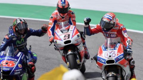 Ducati's Andrea Dovizioso (right) celebrates with Movistar Yamaha's Spanish rider Maverick Vinales (left)