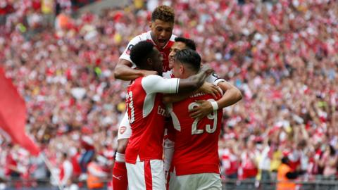 Arsenal celebrate Sanchez's goal