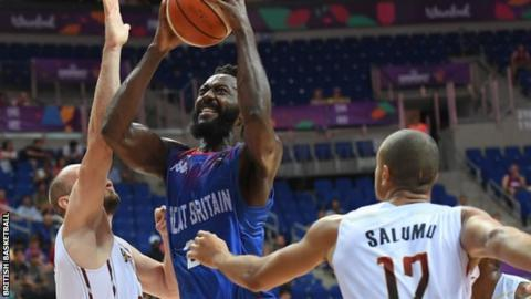 Gabe Olaseni (centre) goes to the basket against Belgium